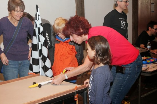 A Raytheon engineer teaches children about propellers using a rocket car.